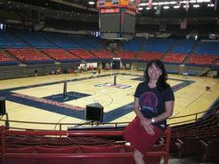 Phoebe Chalk perches on the railing at McKale Memorial Center, which also houses the offices she's called home for the last 15 years. (Photo by Shelley Shelton/University Communications)