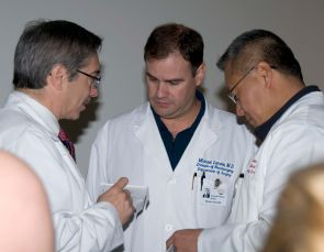 Drs. Steve Goldschmid, Michael Lemole and Peter Rhee discussing medical strategies in the treatment of the shooting victims at UMC.