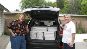 Rock Currier (left) and Robert Downs stand by Downs' rental car before his drive back to Tucson with the second load of the donated mineral collection. Half of the specimens were shipped, but the more delicate ones were packed and driven from LA. (Photo by Mark Candee/UA department of geosciences)