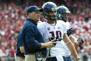 Rich Rodriguez works with players during the game against Stanford. (Photo courtesy of Arizona Athletics)