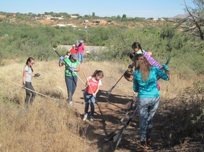 """Girl Scouts work on safe """"back door"""" entry to Pena Blanca Elementary School and Calabasas Middle School, both in Rio Rico. (Photo by Sarah Prasek)"""