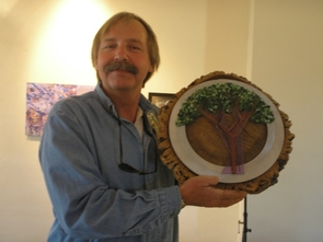 """Facilities Management's David Schereens shows off his piece, """"Junior Tree 1920,"""" made from a piece of a cork oak that was planted by the UA junior class in 1920. (Photos by Shelley Shelton/University Communications)"""
