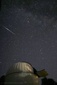 A meteor streaks through a starry sky above the Catalina Sky Survey Schmidt Telescope located on Mt. Bigelow in the Catalina Mountains just north of Tucson, Ariz. (Photo: Catalina Sky Survey)