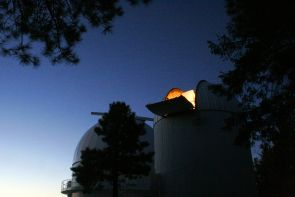 Peering through its open dome, the Schmidt Telescope is ready for another night of searching for asteroids. (Photo: Catalina Sky Survey)