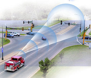 """An emergency vehicle """"talks"""" to a smart traffic system. (Illustration courtesy of the U.S. Department of Transportation)"""