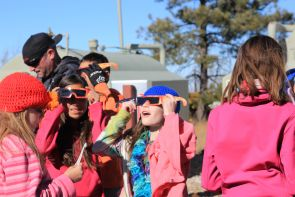 Students don protective glasses to look at the sun at the summit of Mt. Lemmon, just over 9,000 feet. (Photo by Alan Strauss/UA Science: Sky School)