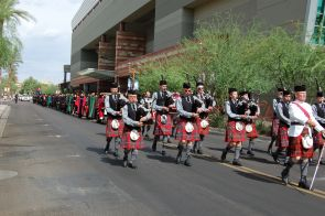 The Phoenix Scottish Pipe Band leads the procession of UA College of Medicine-Phoenix faculty and students from the Phoenix Biomedical Campus to the Phoenix Convention Center.