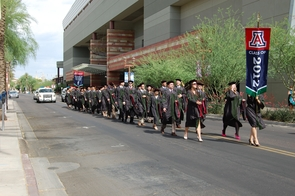The UA College of Medicine-Phoenix class of 2012 processes through downtown Phoenix on its way to graduation ceremonies at the Phoenix Convention Center on May 9. (Photos by Sun Czar Belous and Judy Bernas/University of Arizona), Dr. Stuart D. Flynn, dean of the UA College of Medicine-Phoenix, addresses graduation at the Phoenix Convention Center., Zach Ortiz, the student speaker, at graduation., The Phoenix Scottish Pipe Band leads the procession of UA College of Medicine-Phoenix faculty and students from the Phoenix Biomedical Campus to the Phoenix Convention Center.