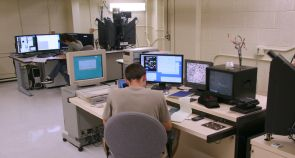 Researchers at the Electron Microprobe Laboratory collect data from the UA's CAMECA SX50 microprobe (front, at right) and the new CAMECA SX100 (back). (Photo by Maria Schuchardt)