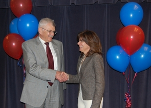 UA President Eugene G. Sander shakes hands with Maria Harper-Marinick, executive vice chancellor and provost of the Maricopa Community College District, after the ceremonial signing of the expanded agreement for community college students to transfer to the UA. The signing was part of a reception held at Paradise Valley Community College in Phoenix. (Photo by Al Bravo/UA College of Medicine-Phoenix)