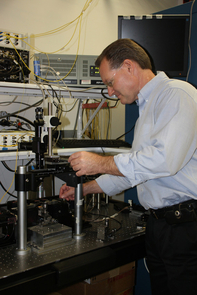 John Wissinger sets up a photonic circuit measurement. (Photo by Beatriz Verdugo/UANews)