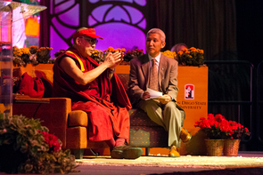 His Holiness the 14th Dalai Lama, with his translator Thupten Jinpa, answers audience questions during his April 19 lecture at San Diego State University. (Photo by Tim Mantoani)
