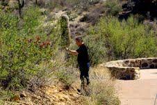 Astronomer Xu Zhou from the National Astronomical Observatory of China stops to take photos of the desert near Tucson during a 2009 visit to Kitt Peak. (Photo by Edward Olszewski)
