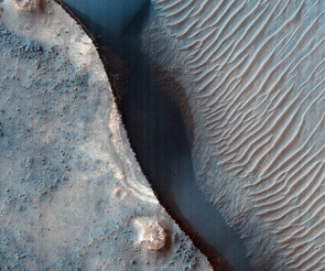Layered deposits form waves upon the floor of a southern-latitude crater on Mars. (Image: NASA/JPL/University of Arizona)