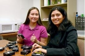Assistant professor Susan Lysecky, left, and graduate student Anuradha Phalke demonstrate some of the eBlocks they have designed and built. They hope these eBlocks, which can be hooked together to make electronics projects and test equipment, will show today's middle school students that science and math are not only worth studying – but fun and exciting, too. (Photo by Matt Brailey)
