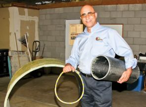 Mo Ehsani displays fiber-reinforced polymer underground pipes at the QuakeWrap facility in Tucson, Ariz. (UA College of Engineering photo)