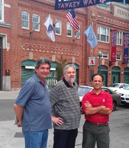 """The UA's Ricardo Valerdi (right) recently traveled to Fenway Park and met with (from left) Andy Andres, a Boston University professor and the MIT Science of Baseball program founder; Bill James, the legendary Red Sox pioneer of sabermetrics, the premise behind the 2011 movie """"Moneyball""""; and Tim Zue (not shown), vice president of Fenway Sports Management and director of business development for the Boston Red Sox."""