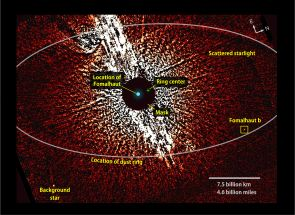 This visible-light image from the Hubble Space Telescope shows the vicinity of the star Fomalhaut, including the location of its dust ring and disputed planet, Fomalhaut b. A coronagraphic mask helped dim the star's brightness. This view combines two 2006 observations that were taken with masks of different sizes (1.8 and 3 arcseconds). (Image: NASA/ESA/T. Currie/U. Toronto)