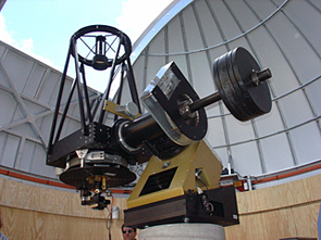 The 20-inch John Jamieson Telescope is equipped with a state-of-the-art 256 x 256 mercury-cadmium-tellurium infrared detector array.  That's the same kind of infrared detector array that UA scientists developed for the infrared camera flying on the Hubble Space Telescope.  Infrared light has longer wavelengths than visible light. It is the light emitted by objects far away and far back in time, near the beginning of the universe. (Photo: Lori Stiles)