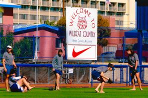 Members of the USA Softball Women's National Team stretch before practice at Hillenbrand Stadium. (Photo by John de Dios)