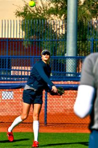 USA Softball pitcher and former Wildcat Jennie Finch warms up during practice at Hillenbrand Stadium. (Photo by John de Dios)