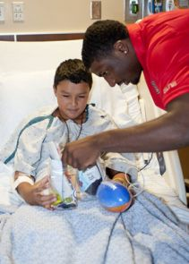 Members of the men's basketball team recently visited with children at The University of Arizona Medical Center-Diamond Children's. (Photo courtesy of Arizona Athletics)