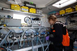In the ship's lab, Melissa Duhaime filters viruses from ocean water samples. (Photo: Anna Deniaud/Tara Oceans)