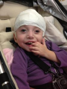 """A child with Dravet Syndrome - a severe form of epilepsy that interferes with normal brain development. In two of the children whose DNA was analyzed for this study, the researchers discovered a genetic mutation causing Dravet Syndrome, providing an answer to their """"diagnostic odyssey."""" (Photo courtesy of the Dravet Syndrome Foundation)"""