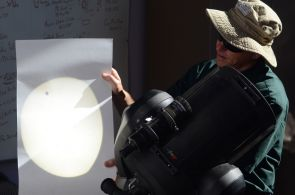 Projecting the Sun's image with the small dot of Venus onto a piece of paper, SkyCenter Director Alan Strauss re-creates the first historic recording of a Venus transit made in 1639. (Photo: Patrick McArdle/UANews)  Photo: Patrick McArdle/UANews