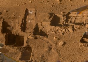Several of the trenches dug by NASA's Phoenix Mars Lander are displayed in this approximately true color mosaic of images from the lander's Surface Stereo Imager camera.  The component images were taken on various dates during the five months that Phoenix studied its surroundings after landing on a Martian arctic plain on May 25, 2008.  The Phoenix Mission was led by the University of Arizona, Tucson, on behalf of NASA. Project management of the mission was by NASA's Jet Propulsion Laboratory, Pasadena, Calif. Spacecraft development was by Lockheed Martin Space Systems, Denver. (Credit: NASA/JPL-Caltech/University of Arizona/Texas A&M University)