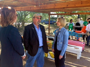 (From left) Erica Schwartzmann, AmeriCorps State Program administrator with the Governor's Commission on Service and Volunteerism and Bob Shogren, director of the Governor's Commission on Service and Volunteerism (center) speak with National 4-H Council CEO Jennifer Sirangelo. (Photo: Kirk Astroth)