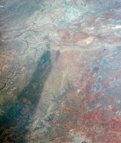 For comparison, this image of Texas obtained by astronauts aboard NASA's Gemini 4 spacecraft on June 5, 1965, shows a large dark swath attributed to rainfall. The dark areas correspond to regions that received more than one inch of rain in the days before the image was obtained. The large swath is about 16 kilometers (10 miles) across near the western (left) end. (Image: NASA/Johnson Space Center)