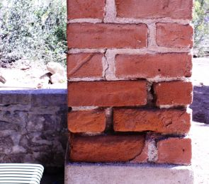 Damage caused by subsidence is visible in this and other columns supporting Old Main. (Photos by Jeff Harrison/UANews)