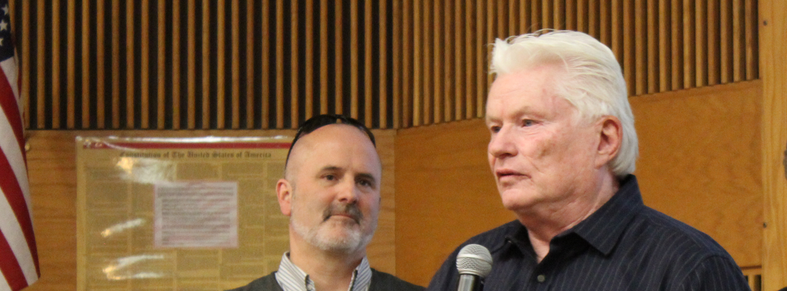 Fletcher McCusker (right) speaks at the 2018 Tech Launch Arizona I-Squared Awards, where he was honored with the award for Ecosystem Impact. TLA Assistant Vice President Doug Hockstad looks on. (Photo: Paul Tumarkin/Tech Launch Arizona)