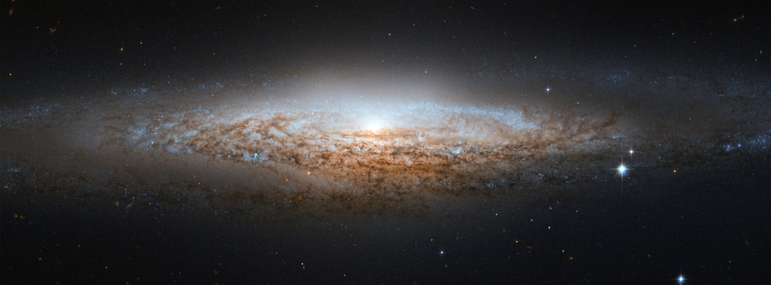 "What our Milky Way might look like to alien astronomers: This image of NGC 2683, a spiral galaxy also known as the ""UFO Galaxy"" due to its shape, was taken by the Hubble Space Telescope. Since trying to find out what the Milky Way looks like is a bit like trying to picture an unfamiliar house while being confined to a room inside, studies like this one help us gain a better idea of our cosmic home. (Image: ESA/Hubble & NASA)"