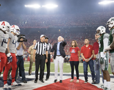 To start the game, U.S. Sen. John McCain of Arizona flipped a coin from the 47th Pursuit Squadron at Davis-Monthan Air Force Base in Tucson. (Photo: Stan Liu/Arizona Athletics)