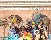 Members of Grupo Coatlicue perform during the exhibition.