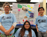 Team Fantastic Four members Adriana Morales, Jaylee Yellowhair and Francisco Pedroza present their week's findings during the BlastOff! camp. On the last day of camp, parents and other family members were invited to the informal poster session.
