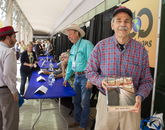 "Author Bob ""Boze"" Bell (background) and Russ Luke at the Integrated Learning Center author signing area. While seeking Bell's autograph, Luke discovered they had grown up in the same town of Kingman, Arizona."