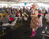 Paula Erlene of Phoenix performs in the dining tent.