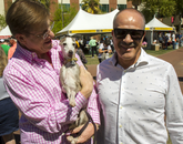 Keith Hoshal and Hector Gomez of Los Angeles show Bo around the festival.