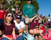 """""""This is history for the UA,"""" says Samantha Rodriguez (right), a sophomore majoring in astronomy at the UA, with her husband and daughter. """"Hopefully by the time I graduate, I will be able to work on something like this."""" (Photo credit: Ernesto Trejo/UANews)"""