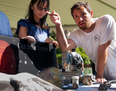 A student in the UA's Department of Geosciences explains what meteorites can tell us about the origin of the solar system. (Photo credit: Ernesto Trejo/UANews)