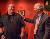 Antiques dealer David Van Auker, who found the de Kooning artwork, is congratulated by UA President Robert C. Robbins. (Photo: Bob Demers/UANews)