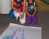 A camper poses with her drawing.