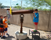 Campers explore the giant kaleidoscope at the Sonoran Glass School.