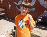 A camper poses during a field trip to the Sonoran Glass School.