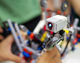 The sensor on each of the robots interprets the color of the playing field it is currently over to help dictate its behavior.