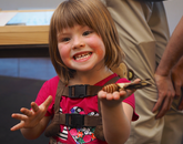 Visitors like Sarabel Olshefski were able to hold silk moths and southern Arizona beetles, among other insects.