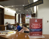 """Sept. 9, 12:01 p.m.: Erin Przybylinski (right), a student in the James E. Rogers College of Law, is a student recruiter and was visiting Old Main for the first time. """"It looks older on the outside, yet very beautiful and new."""""""